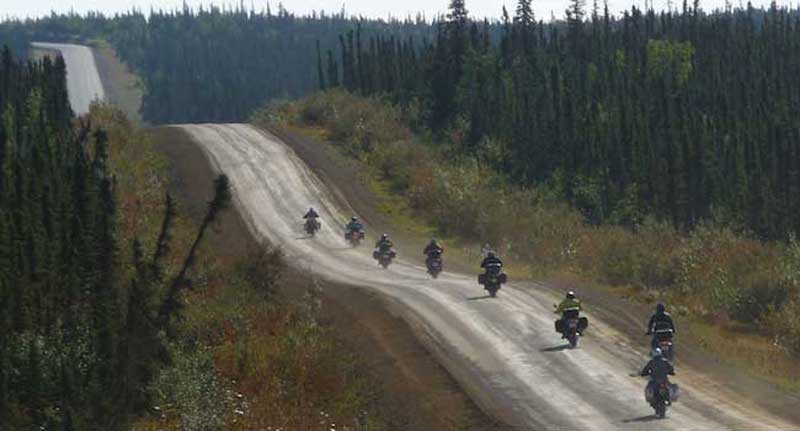 A line of riders heading up the Dalton Highway